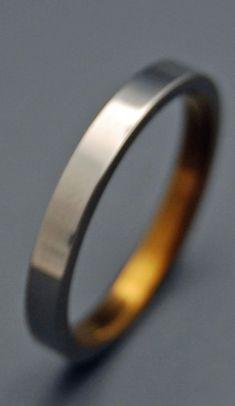 Slim Sleek and Bronze Titanium Wedding by MinterandRichterDes
