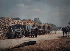 Vivid color photos of 1923 Paris, hub of artistry and progress. A worker naps next to carts of rubble.