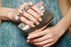 Take your outfit from stylish to stunning with this luxurious, metallic clutch. Put a ring on it with the glamorous finger-loop top which makes it effortlessly easy to carry.