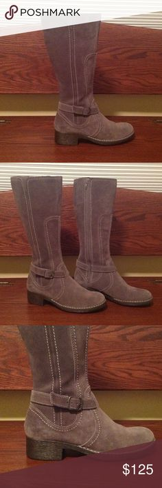 """NWT - Clark's Grey Suede Boots A GORGEOUS pair of Clark's suede boots in the most beautiful grey color I've seen on a boot!  These boots have a lighter grey stitching on them that really makes these boots stand out in a crowd.  This suede is SO SOFT!  There's an adjustable band that runs around the boot right at the ankle.  The buckle is a steel grey.  2"""" black heels.  Approx 16"""" at the top.  Side zip.  Lined with a warm, fleece-like material. Never worn.  Come in original box. Clarks Shoes…"""