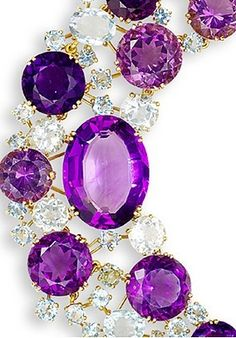 Close up of Verdura amethyst and aquamarine necklace. Highly articulated necklace graduating in size from the centre, set throughout with amethysts and aquamarines of both oval and circular-shape and of various sizes, to a concealed clasp, unsigned, length 53.0cm