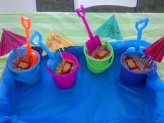 """Our 4th of July pudding dessert for the kids...""""Sand"""" in a beach bucket with a shovel for a spoon and a teddy graham laying out on a towel."""