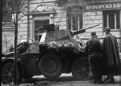 "German soldiers near a ""Autoblinda"" AB 43 Italian made armoured car. Photo taken through the window of a Cafe in the heart of Belgrade on the 15th October 1944, on the streets of Milan, on the eve of the storming of the city by the Soviet & Yugoslav troops in ."