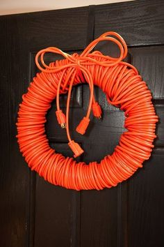 I need to make a couple of these!  Man wreath... I think I might do this in Christmas colors. That way he has a way to plug all his christmas lights in without all the extra cords hanging around Too funny mancave wreath