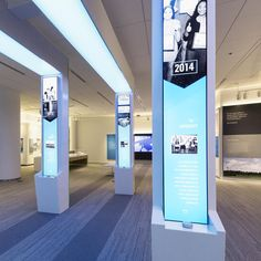 The Beacons and Values pillars at the Cox Discovery Center are connected by an overhead LED ribbon that changes color as visitors scroll… Exhibition Stall, Exhibition Stand Design, Exhibition Display, Showroom, Event Signage, Column Design, Timeline Design, Co Working, Digital Signage