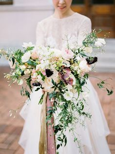 Dramatic statement bridal bouquet with white, pink, lots of green and touches of black // A historical building in The University of Hong Kong inspired the vision for this styled shoot captured by Lara Lam and planned by Ultimate Wedding HK. Lara grew up in Hong Kong and studied in France, and it is perhaps precisely her appreciation of Gallic and old world European aesthetics that lends itself to these beautiful bridal portraits.