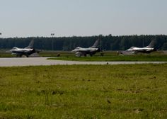 Three U.S. Air Force F-16 Fighting Falcons taxi during BALTOPS 14 at Lask Air Base, Poland, June 9, 2014. This is the first exercise to include a large amount of aircraft that will provide air-to-air and air-to-ground support. This training increases readiness for real-world operations with NATO allies and takes place from June 9-19, 2014. (U.S. Air Force photo by Airman 1st Class Kyle Gese/Released)