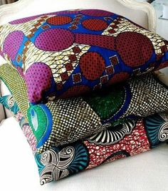 I should make pillows like this with all the fabric I brought from Kenya