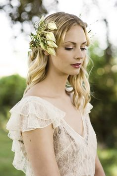Simple elegance, white flowers in her hair. Cecile french lace wedding dress in blush by www.lapoesie.co.uk Photography Carey Sheffield Photography Hair and make up by Essex Wedding Beauty Styling by Bijou Bride