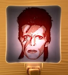 A personal favorite from my Etsy shop https://www.etsy.com/listing/510682155/david-bowie-night-light-fused-glass