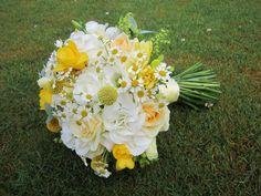 Lemon , yellow , whites and cream flowers in this wedding Brides handtied bouquet. Yellow craspedia balls , white hydrangea , daises , lemon roses , yellow fressia .