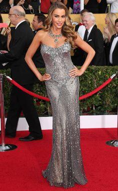 Sofia Vergara in a sparkly silver Donna Karan Atelier dress. See all the SAG Awards Red Carpet looks: http://uk.bazaar.com/1eYuquo