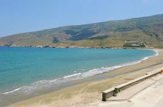 #Andros #Geece KORTHI Location: At Korthi #village, in the southeastern side of the #island.  Special features: It is a large #beach with clear blue waters. Strong winds make it ideal for #surfing, but hinder those who enjoy #swimming in calm waters.  How to get there: Very easily, by car or the local bus service. It is located 14 km from Chora and 35 km from port of Gavrio.