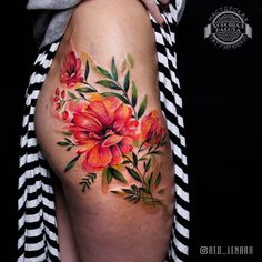 Gorgeous watercolor floral piece that wraps the hip