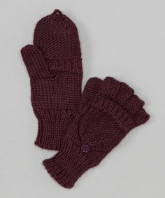 Stay cozy and chic in these knit mittens. Their convertible design is crucial for staying toasty while texting!