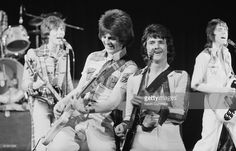 Scottish pop group the Bay City Rollers performing at the Birmigham Odeon, 1975. Left to right: Alan Longmuir, Eric Faulkner, Les McKeown and Stuart 'Woody' Wood.