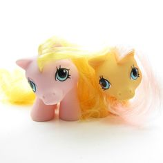 This set of My Little Pony twins includes Dibbles and Nibbles, they're Newborn Twins Ponies from Year 5. The set includes Dibbles, Nibbles, and some of their original accessories