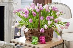 Try a new take on the Easter basket: Arrange tulips in low glass containers (using flower frogs so that the stems stand upright), then tuck them into a classic handled basket.