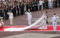 Prince Albert and Princess Charlene of Monaco, the brides 18 foot long train was designed by Giorgio Armani and was  visual masterpiece. Best modern royal bride!