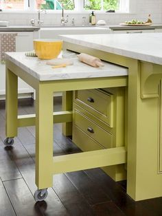 Love when a design plan is well thought out!  Creative Counter Space: Creative stow-and-go solutions are a must in a small kitchen space. Here, a rolling cart tucks neatly into this island to offer additional workspace as needed. The cart can be wheeled throughout the kitchen to give multiple cooks room for meal prep and staging.