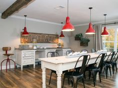 It's hard not to fall in love with these industrial red pendulum lights! The are exactly the right amount of color for this rustic farmhouse eating area.