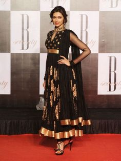 Deepika Padukone in black chinese collor anarkali with gold border and thread work by Ritu Kumar - MinMit Clothing