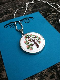 tree of life: hand embroidered pendant-necklace.via Etsy.