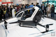 """This supersized drone will fly you to work (or anywhere) - It's happened. Someone built a quadcopter big enough to carry human cargo. The future is officially here, and it's kinda scary. Scary in the cool way though. The same company that brought us the regular-sized Ghost drone has just announced the """"184"""" Personal Flying Vehicle (PFV). It's about the size of a (very) small car, and claims to be able to deliver one human anywhere within a 10 mile/23 min flight time reach. #CES2016"""