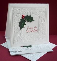 My November cards have been made a while but I have just not found time to put them in my gallery and now November is nearly gone!!!! These are really simple - dry embossed frame using a brass stencil with a few holly die cuts and red pearls ... Thanks for stopping by all comments very much appreciated :)