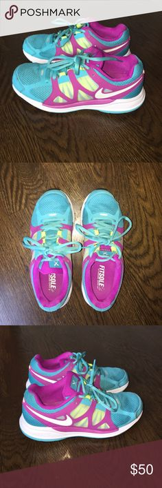 Nike Zoom Elite + 5 Running Shoe In the color turquoise/white/vivid grape/volt.  Great condition.  Very minor wear/marking to sole edge, sole, interior and front toe.  Difficult to see unless very close up. No holes or rips.  Smoke free/pet free home. Nike Shoes Athletic Shoes