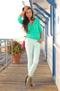 green blouse with white denim