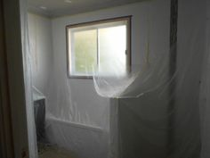 Right hand side - Bath and vantiy covered with plastic, now ready for ceiling spray paint