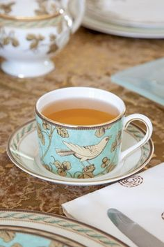 aqua teacup and saucer - now I do like this style and shape.