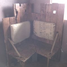 Corner bench built from reclaimed lumber, ship rope and old coffee sacks.