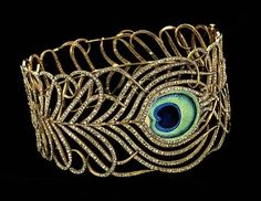 Jeweled Collar in the Shape of a Peacock Feather  1900,  Mellerio dits Meller  Stunning, no?   another here    18 karat gold, enamel, diamonds 23/8 x 43/8 in. (6.1 x 11.2cm.) diam. Smithsonian American Art Museum Gift of Laura Dreyfus Barney and Natalie Clifford Barney in memory of their mother, Alice Pike Barney