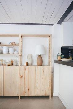 Side-by-side Ikea shelving units in Paris loft.