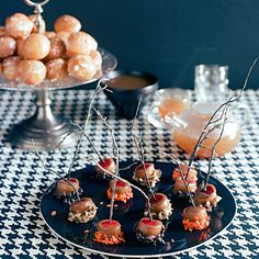 Mini Caramel Apples by Sunset Magazine. You get all the satisfaction of a caramel apple in one bite and without a messy chin. If decorating with twigs, make sure twigs are food-safe or use craft sticks. Caramel Apple Bites, Mini Caramel Apples, Apple Recipes, Fall Recipes, Holiday Recipes, Candy Recipes, Wine Recipes, Dessert Recipes, Halloween Food For Party