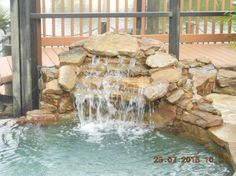 Rock Swimming Pool Waterfall #10 | Uni-Scape Waterfalls, Natural Stone Work, Ponds, Swimming Pool and Spa Renovation, Flagstone Patios and Outdoor Kitchens.