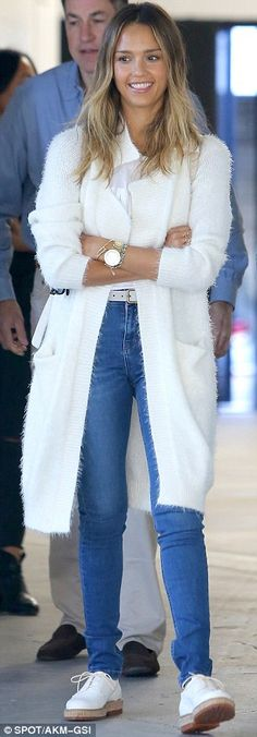 She wears it well: The Machete star paired blue jeans with a white shirt and long white ca...