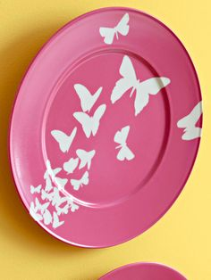 Butterfly Wall Art - you can get chargers inexpensively at Michael's and spray paint those.