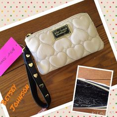 BETSEY Johnson beige puffy wristlet NWT just in NWT BETSEY Johnson beige with gold heart accent wristlet.  Betsey Johnson Bags Clutches & Wristlets