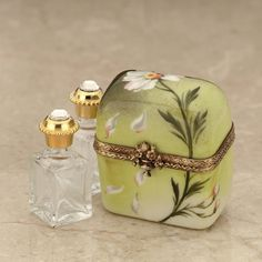 Limoges  perfume chest with daisy and bottles