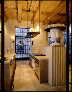 Love the design of this kitchen. Beautiful wall treatment & Wood ceiling & beams. Gorgeous cabintry, travertine flooring & love the lighting treatment that uses real candles to create a beautiful ambiance.kitchen by mcalpine tankersley