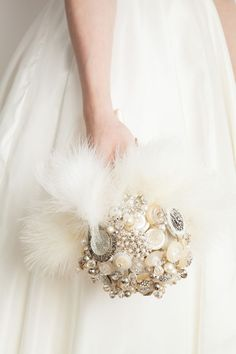 1920 feather and sparkle great gatsby buttton brooch bouquet from bride as a button shop wedding flowers and wedding decorations www.afloral.com #afloral