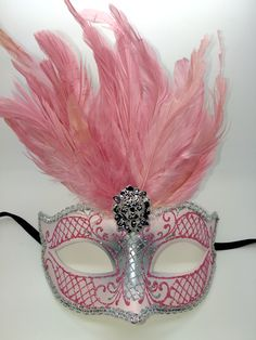 Light pink and silver Mardi Gras mask with black ribbon ties.