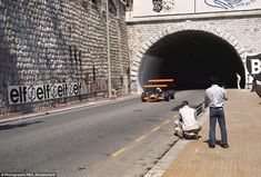It wasn't until 1973 that the tunnel at Monte Carlo was reconfigured to how it looks today as John Surtees' BRM exits what was a shorter version of it in 1969. Safety was still not a major concern in the sport despite the downforce found in the first incarnations of front and rear wings. Two spectators take their chance on a barrier while protection from a lamp post consists of token sand bags