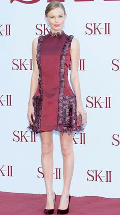 Kate Bosworth wore a feather-embellished Christopher Kane dress