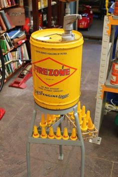 A Golden Fleece service station Firezone upper cylinder lubricant oil stand