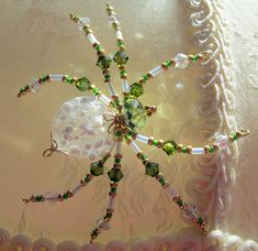 Beaded, Green & Gold, Hand Blown Glass Spider Ornament – Christmas Spider and Legend