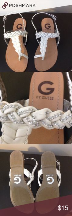 Guess Sandles White Summer Sandle. Worn only a few times. There is some missing chain on both straps (see pictures). Great shape! Shoes Sandals